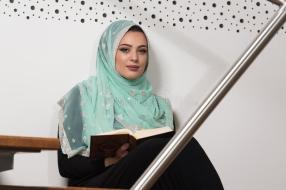 muslim-woman-reading-holy-quran-koran-wearing-traditional-dress-mosque-75583061